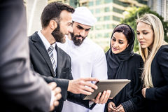 Arabic and western business people. Speaking about investments Stock Photo