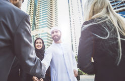 Arabic and western business people. Speaking about investments Royalty Free Stock Photography