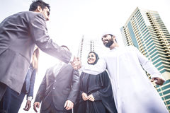Arabic and western business people. Speaking about investments Stock Image