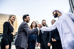 Arabic and western business people. Speaking about investments Stock Photos