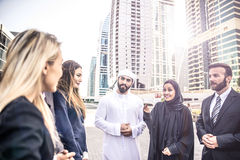 Arabic and western business people. Speaking about investments Royalty Free Stock Photos