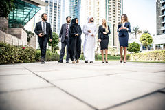 Arabic and western business people. Speaking about investments Stock Images