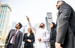 Arabic and western business people. Speaking about investments Royalty Free Stock Image