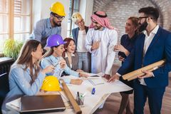 Arabic and western business people speaking about investments. In office Royalty Free Stock Photo