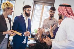 Arabic and western business people speaking about investments. In office Stock Image