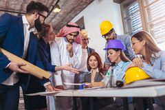 Arabic and western business people speaking about investments. In office Royalty Free Stock Photography