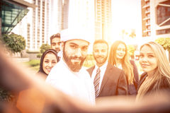 Arabic and western business people. Taking selfie Stock Photos