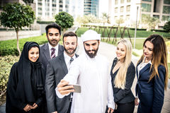 Arabic and western business people. Taking selfie Royalty Free Stock Images