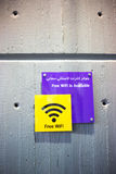 Arabic Wi-Fi sign. Free Wi-Fi sign on a wall in both English and Arabic languages stock photography
