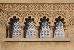 Arabic window. Detailed view of arabic decorated window over brown stone Royalty Free Stock Photography