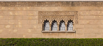 Arabic window and facade. Wide view of arabic decorated window on brown stone Royalty Free Stock Image