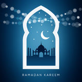 Arabic window with, silhouette of the mosque, moon. Ramadan card. Arabic window with the silhouette of the mosque, moon, stars and bokeh lights. Greeting card Stock Photo
