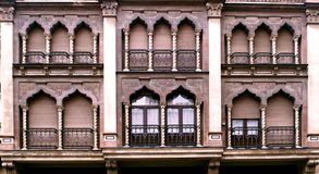 Arabic windows. Several windows with Arabic-style arches with blinds down Stock Photo