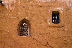 Arabic windows on the old clay wall. Clay adobe building in the Golden Horde reconstructed capital Stock Photography