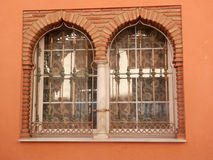 Arabic Windows. Terracotta coloured wall with two arabic windows, Malaga Stock Images