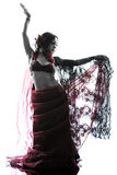 Arabic woman belly dancer dancing. One arabic woman belly dancer dancing silhouette studio isolated on white background Stock Photo