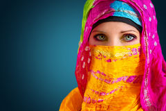 Arabic woman. Colorful portrait of a young Arabic woman,  against blue background Royalty Free Stock Image