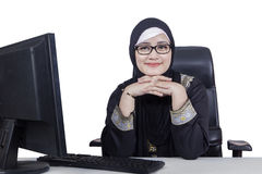 Arabic woman with computer on desk stock photo