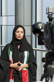 Arabic woman in front of TV-camera. Beautiful arabic woman wearing hijab standing in front of TV camera. Dubai, UAE, United Arab Emirates Stock Photos