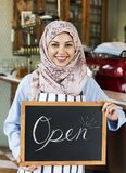 Arabic woman holding an open board Stock Photography
