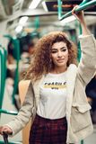 Arabic woman inside subway train. Arab girl in casual clothes. royalty free stock images
