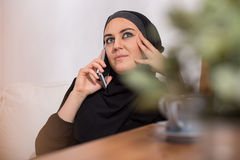Arabic woman with a phone. Young beautiful arabic woman with a phone Royalty Free Stock Photos