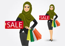 Arabic woman with shopping bags Royalty Free Stock Images