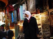 Arabic woman shopping at the bazaar. Arabic woman with white headscarf shopping at the bazaar in Jerusalem. Photo taken on January 11, 2011 Royalty Free Stock Images
