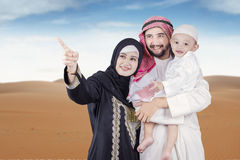 Arabic woman shows something on her family Stock Photo