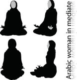 Arabic woman silhouette in meditating pose, isolated on white background Royalty Free Stock Photo