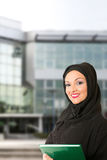 Arabic woman traditional dressed, in front of the building. Arabic woman, traditional dressed, standing in front of the building Royalty Free Stock Photo