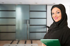 Arabic woman, traditional dressed, in front of the office Stock Photos