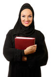 Arabic woman, traditional dressed,holding book. Arabic woman, traditional dressed, with book in her hands Royalty Free Stock Photo