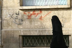 Arabic Women. The streets of Aleppo with an Arab woman in traditional clothing in Syria Stock Images