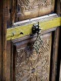 Arabic wooden door with knocker. Antique arabic wooden door with knocker Stock Photos