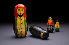 Arabic wooden nesting dolls family values. Arabic wooden nesting dolls showing the concept of broken family values Royalty Free Stock Image