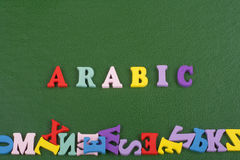 ARABIC word on green background composed from colorful abc alphabet block wooden letters, copy space for ad text. Learning english concept stock images