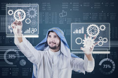 Arabic worker working with futuristic screen Royalty Free Stock Images