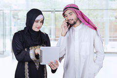 Arabic workers discussing in the office lobby Stock Photos
