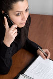 Arabic young businesswoman. With phone and documents Royalty Free Stock Images