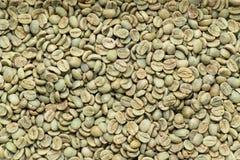 Arabica φασόλια καφέ, υπόβαθρο Στοκ Φωτογραφίες