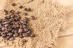 Arabica coffee bean. On Sack wood background Stock Image