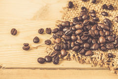 Arabica coffee bean. On wood background Royalty Free Stock Photo