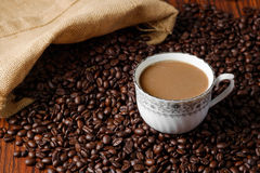 Arabica coffee beans. Medium roasted Arabica coffee beans with a cup of coffee Stock Images