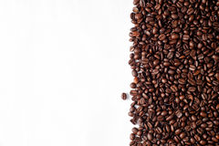 Arabica coffee beans. Medium roasted Arabica coffee beans with isolated white background Stock Photo