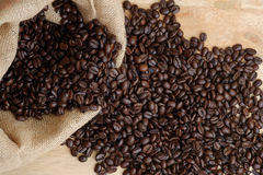 Arabica coffee beans. Medium roasted Arabica coffee beans in sacks Royalty Free Stock Photography