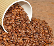 Arabica Coffee Beans And Takeaway Cup Royalty Free Stock Photo