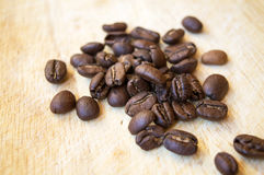 Arabica coffee beans on wooden background Royalty Free Stock Images