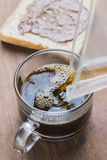 Arabica coffee cup. Cup of espresso coffee making by homemade with chocolate bread Stock Photos
