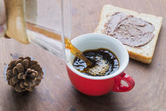 Arabica coffee cup. Cup of espresso coffee making by homemade with chocolate bread Royalty Free Stock Photo